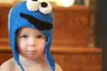 baby wearing a crocheted monster hat